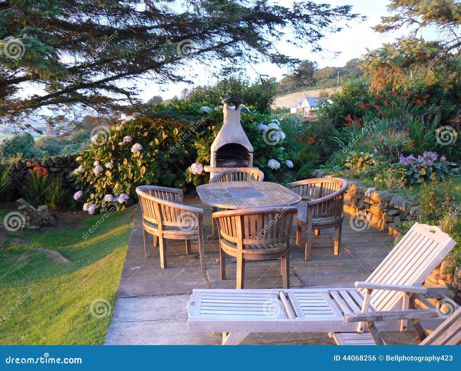 English Garden With Luxury Wooden Garden Furniture Stock