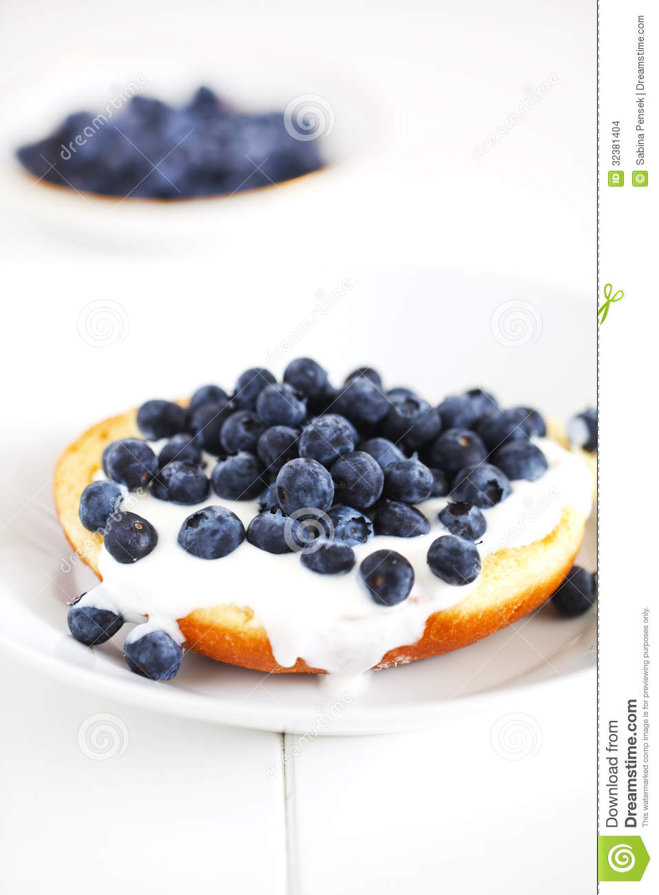 English Muffin With Cream And Blueberries, Breakfast Stock Photo