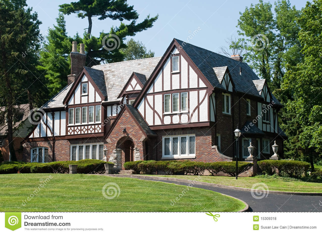 English tudor home stock photo image of gabled american for Tudor house plans with photos