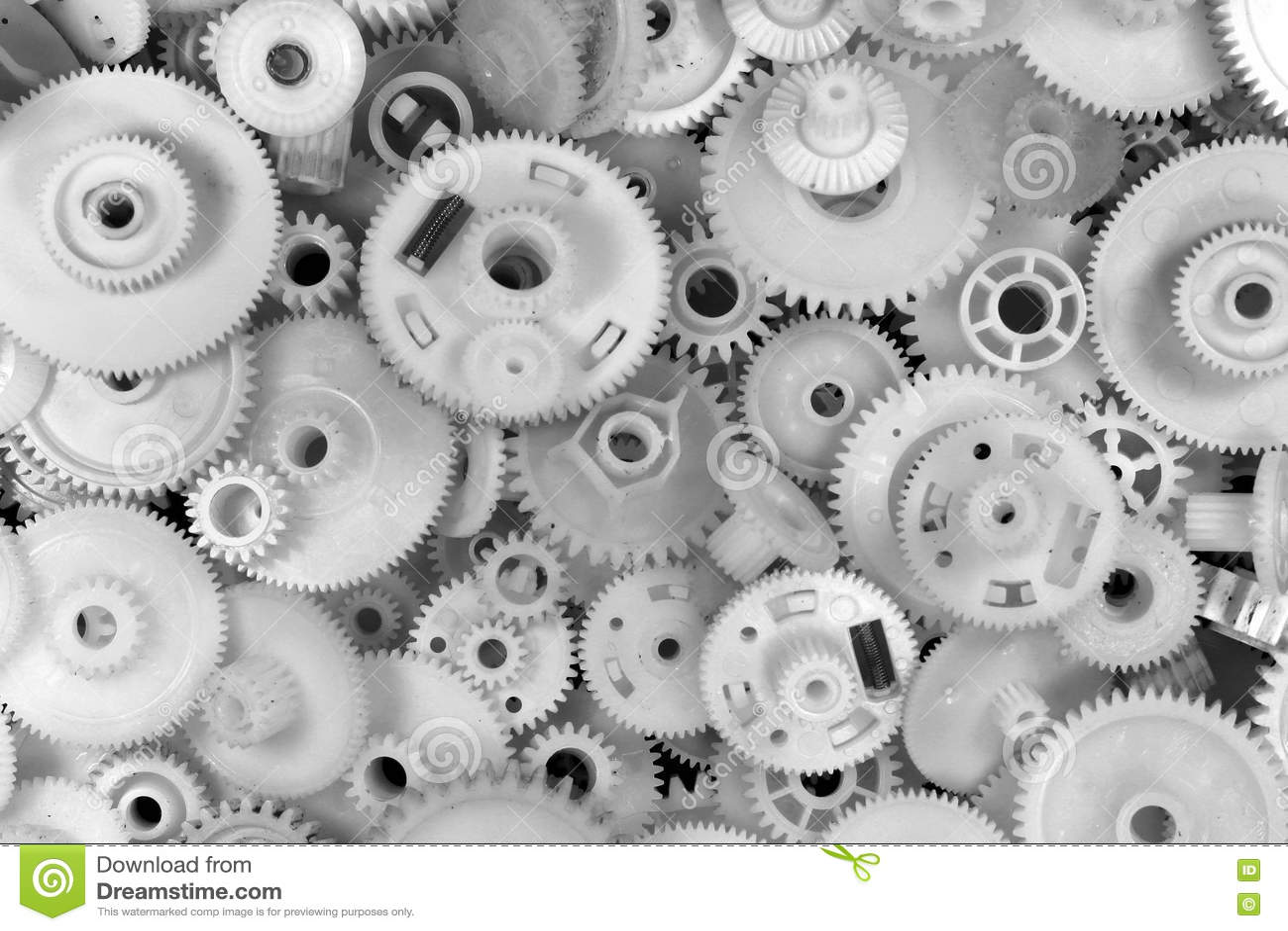 Engranajes y ruedas dentadas plásticos blancos en fondo negro