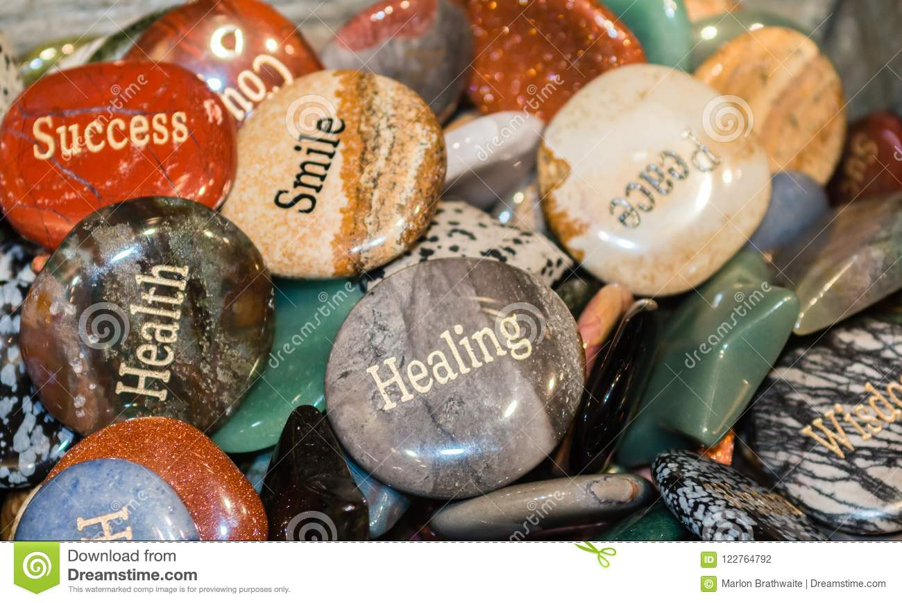 engraved rocks that show words of wisdom and encouragement stock