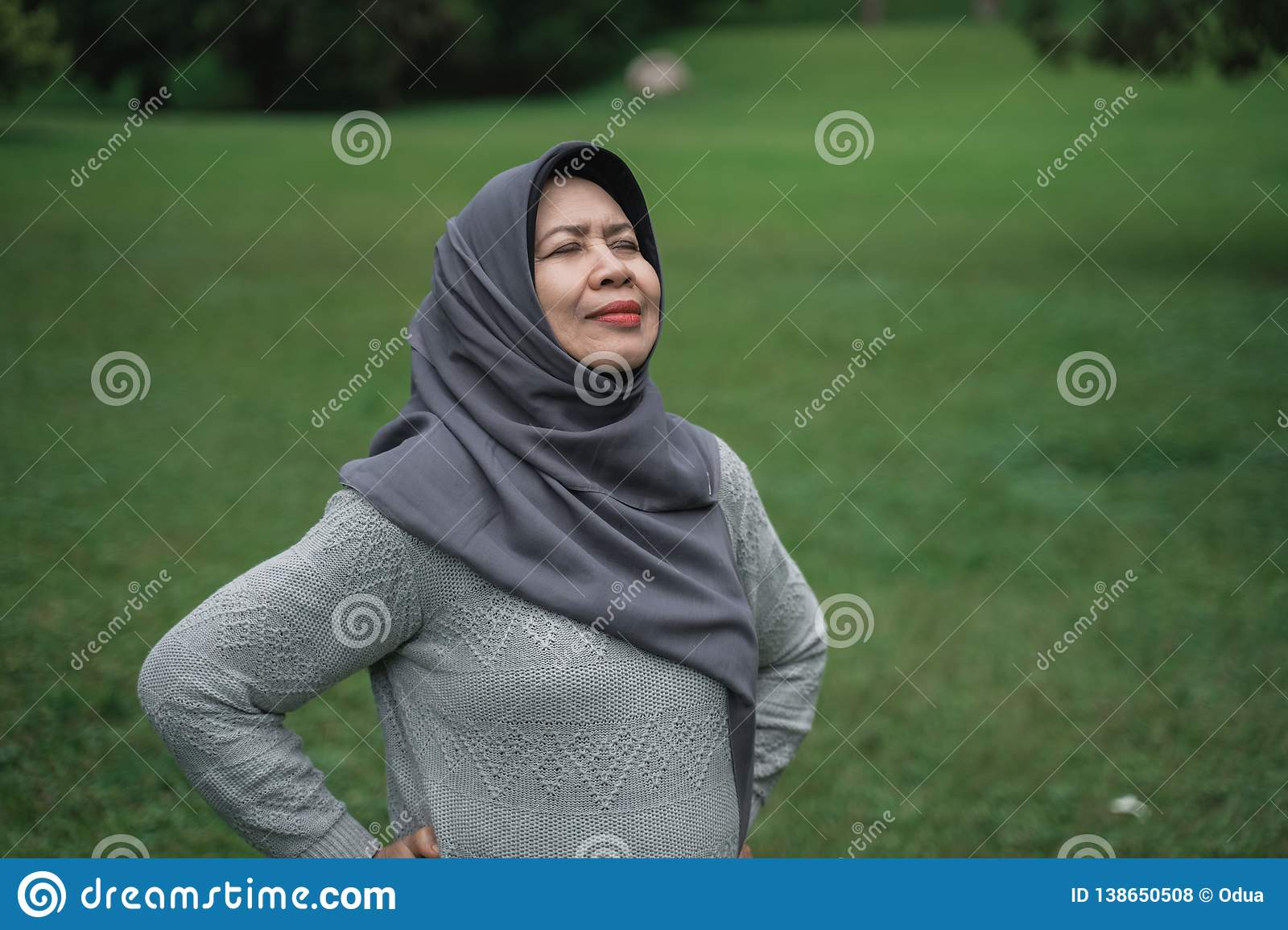 Enior muslim woman relaxing taking deep breath and stretching
