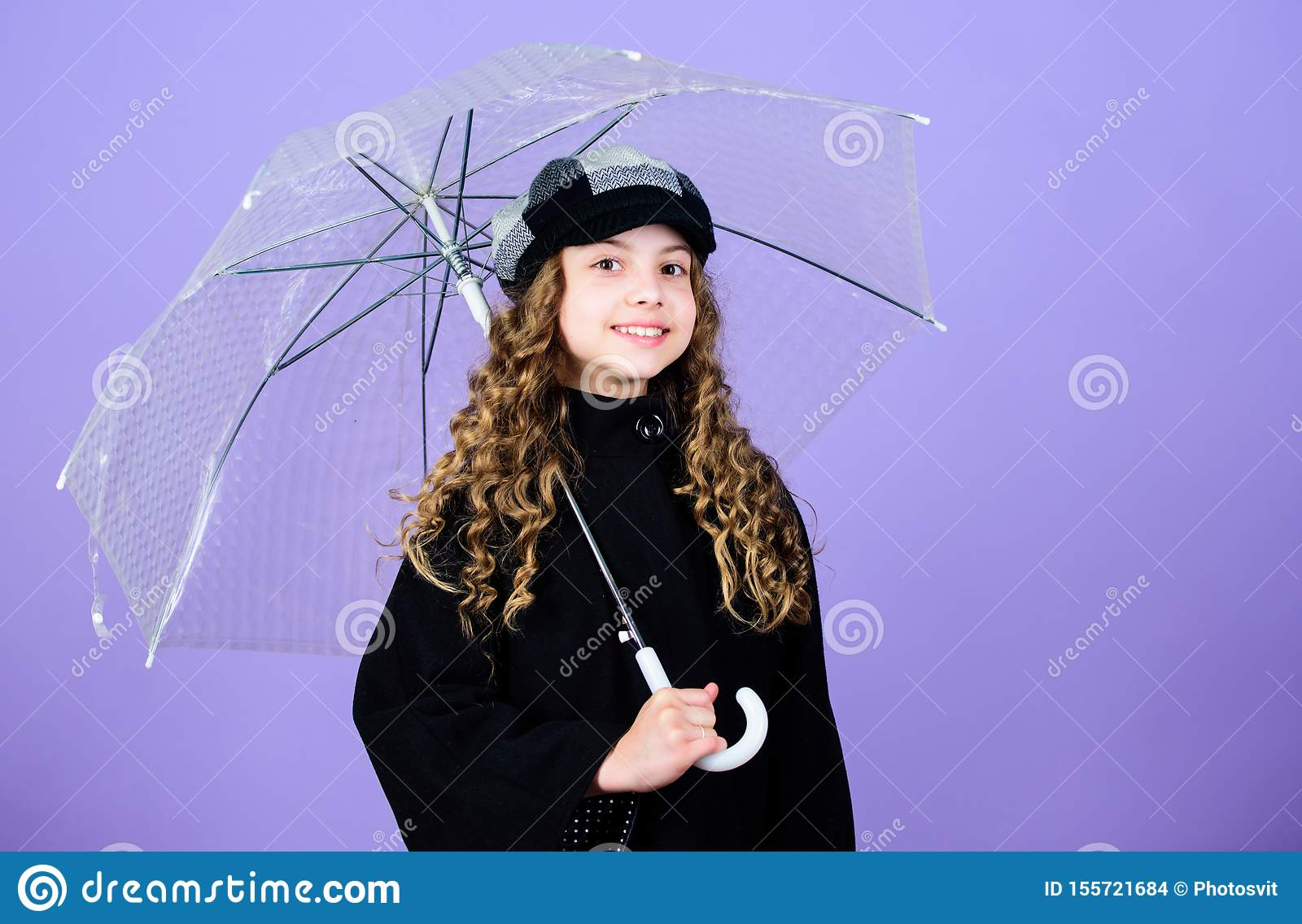 Enjoy rainy weather with proper garments. Waterproof accessories make rainy day fun. Fall season. Enjoy rain concept