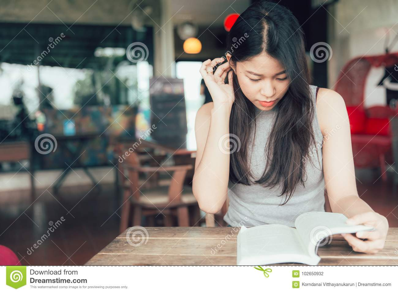 Enjoy relax times with reading books Asian women beautiful Thai teen read a book
