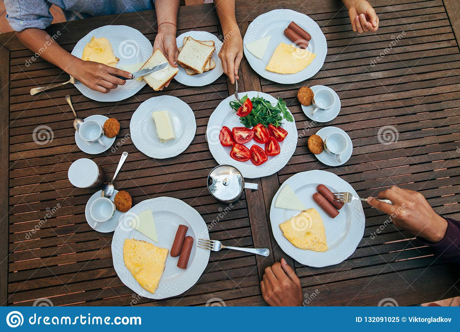 Top view of group of people having breakfast together