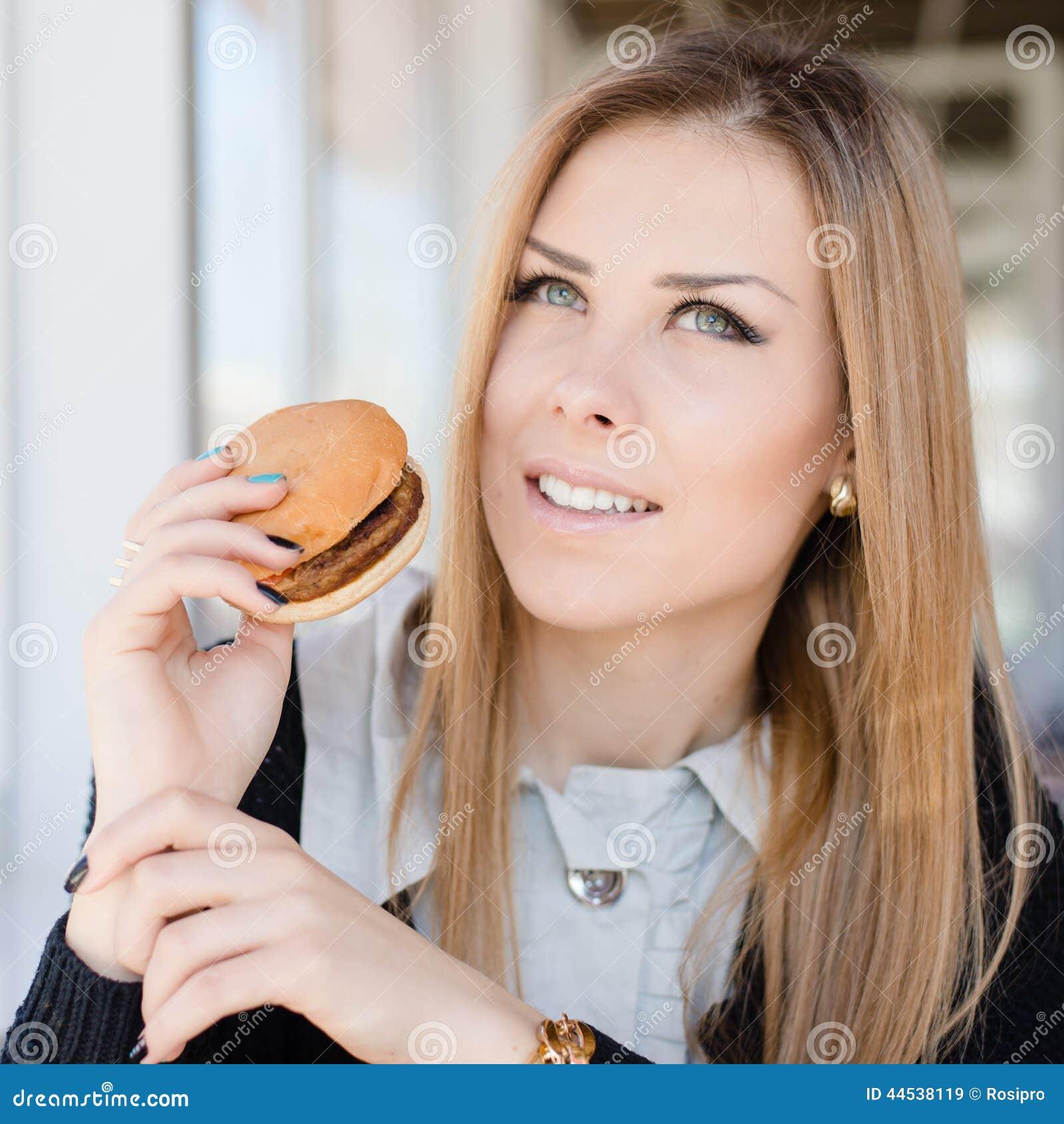 Happy Beautiful Woman Enjoying At Beach Stock Photo: Enjoying Burger: Eating Delicious Hamburger Beautiful