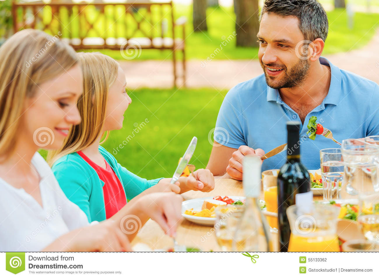 Enjoying dinner together stock photo image 55133362 for Meal outdoors
