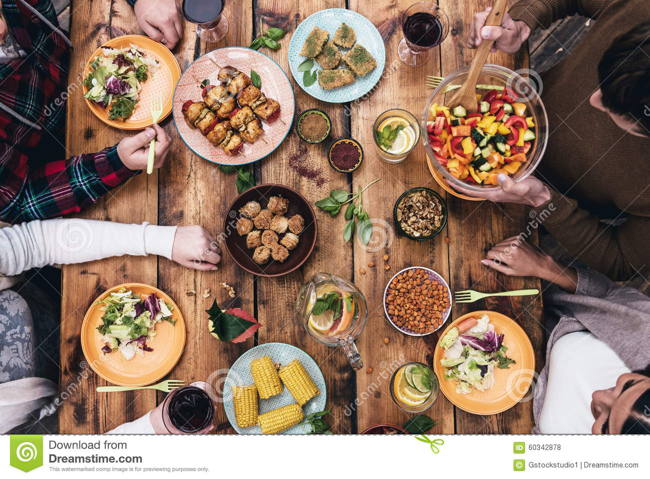 Enjoying Dinner Together Stock Photo Image 60342878 : enjoying dinner together top view four people having sitting rustic wooden table 60342878 from www.dreamstime.com size 1300 x 958 jpeg 292kB