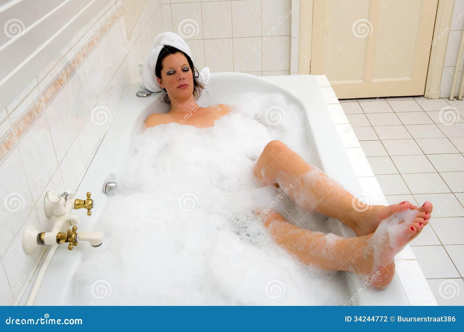 Enjoying a hot bath stock photography image 34244772 for Hot bathrooms photos