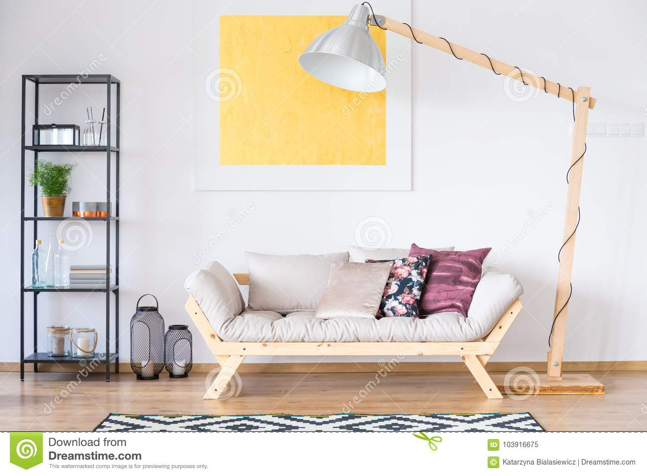 Enormous lamp standing by couch
