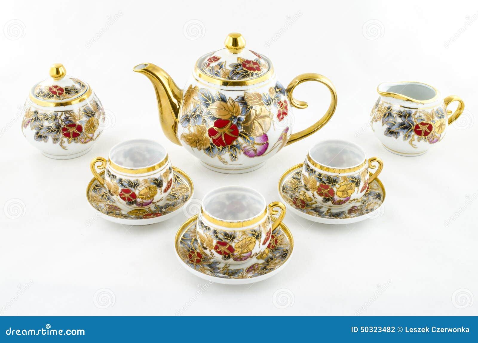 Ensemble antique de thé et de café de porcelaine avec le motif de fleur