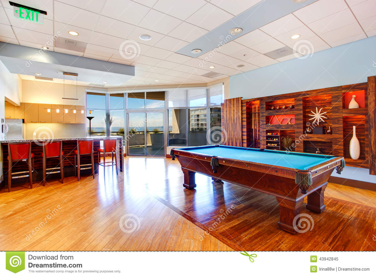Entertainment Room With Pool Table And Walkout Deck Stock