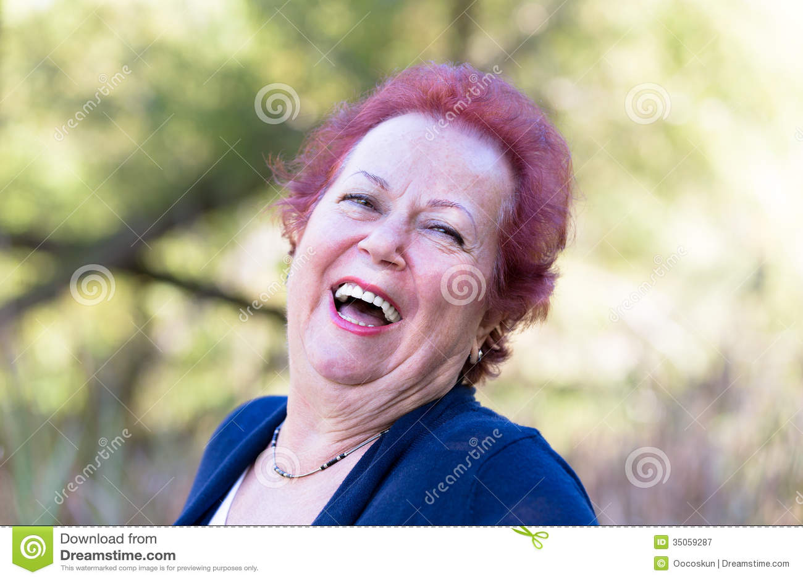 Enthusiastic Senior Woman Giving a Genuine Laugh
