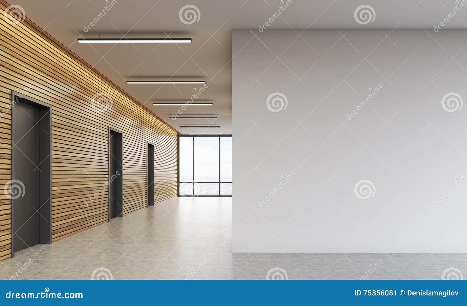 Entrada do escritório com parede branca