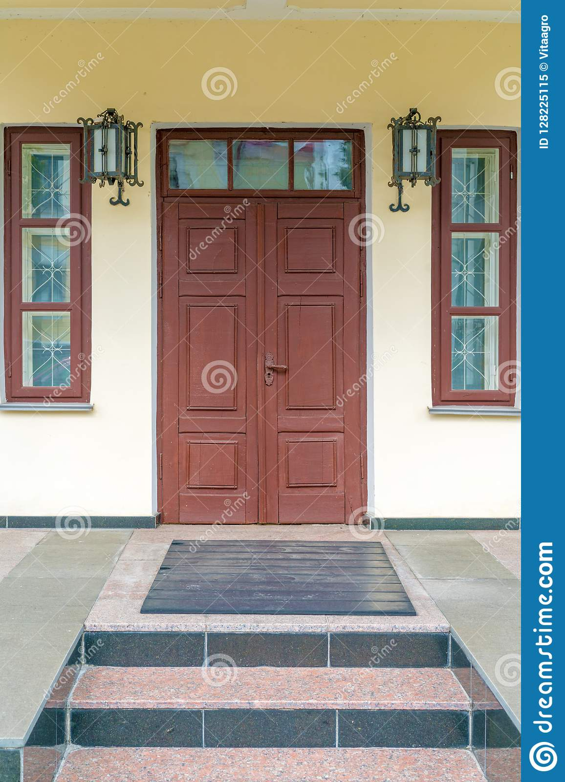 hot sales 0b0d1 ea12c Entrance Door, Two Windows, Two Lamps On The Front Of The ...