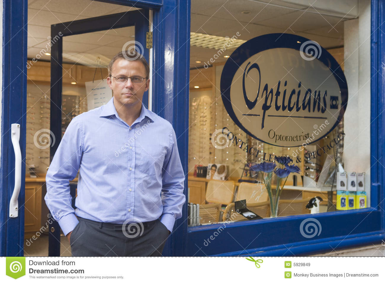 Entrance front man optometrists standing