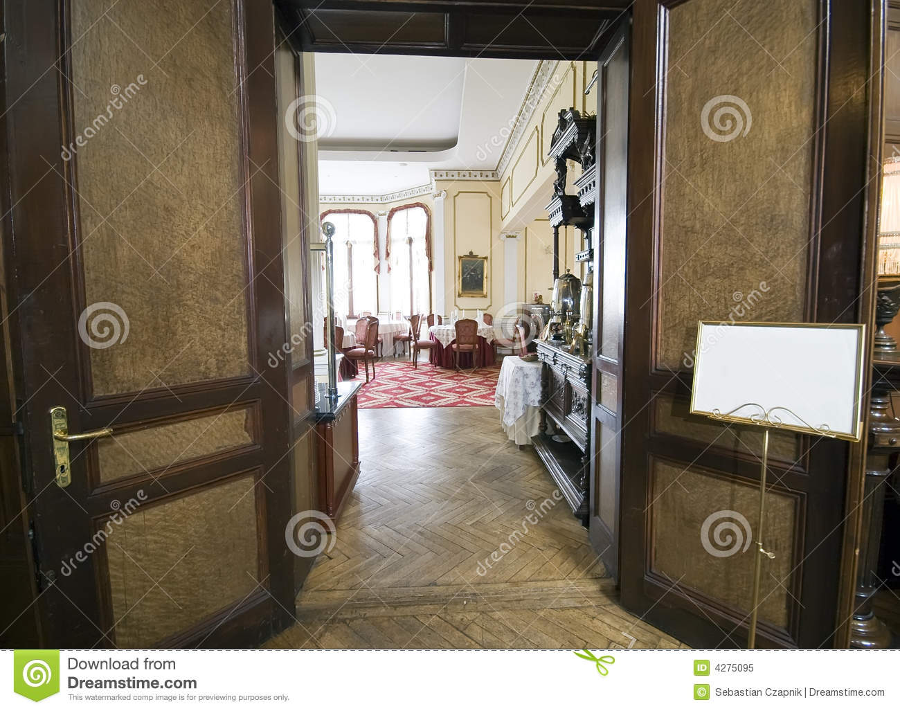 Textured Wood Hallway And Fancy Dining Room