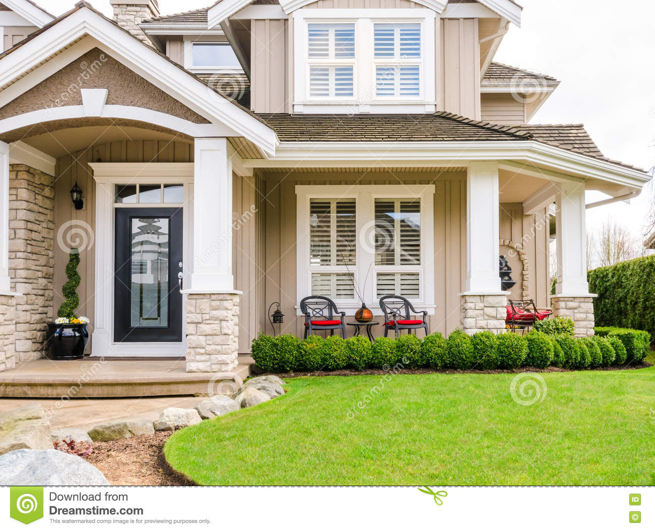 Entrance Of A Luxury House With Beautiful Landscaping On A Bright, Sunny  Day. Home Exterior Design.