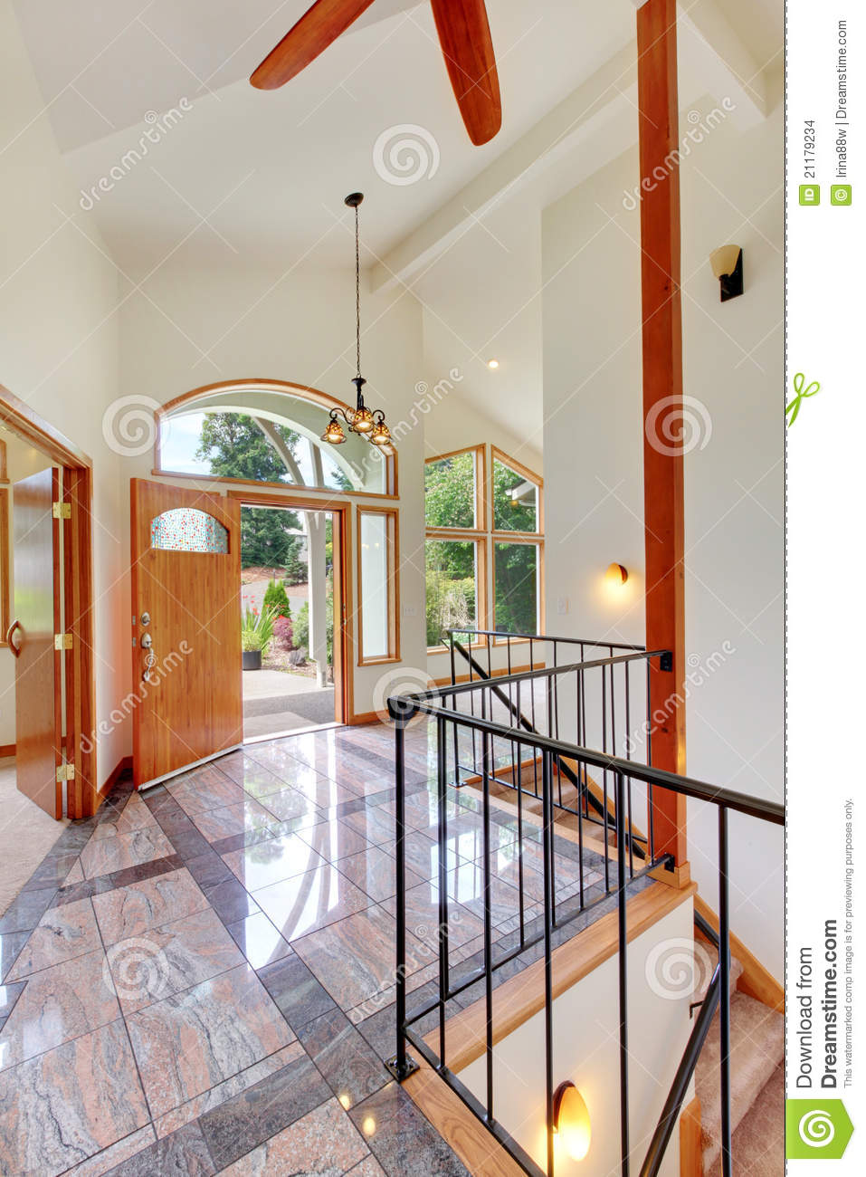 Entrance with marble floor high ceiling and door