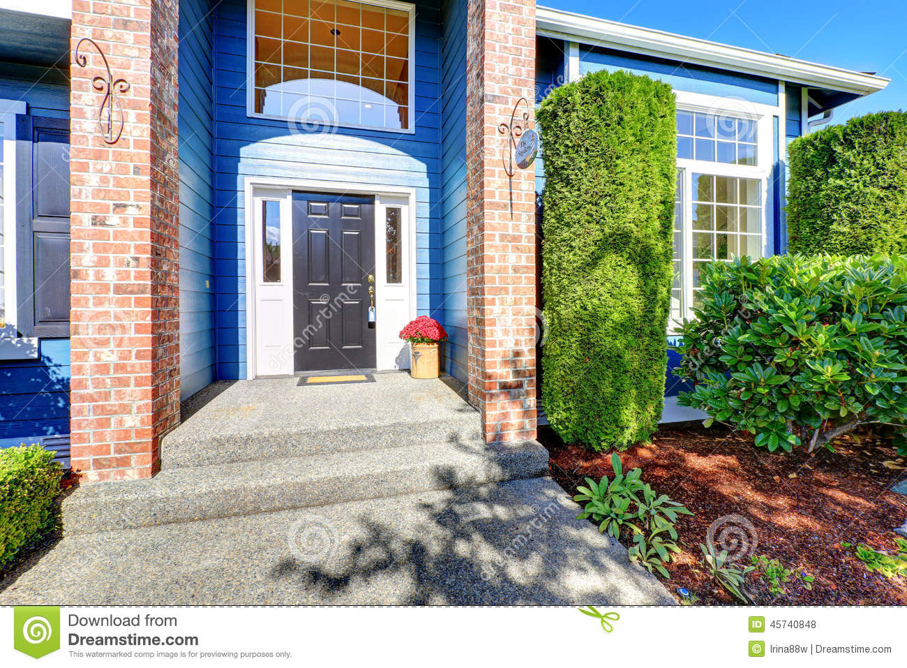 Entrance porch with brick wall trim and high ceiling stock for American house exterior design