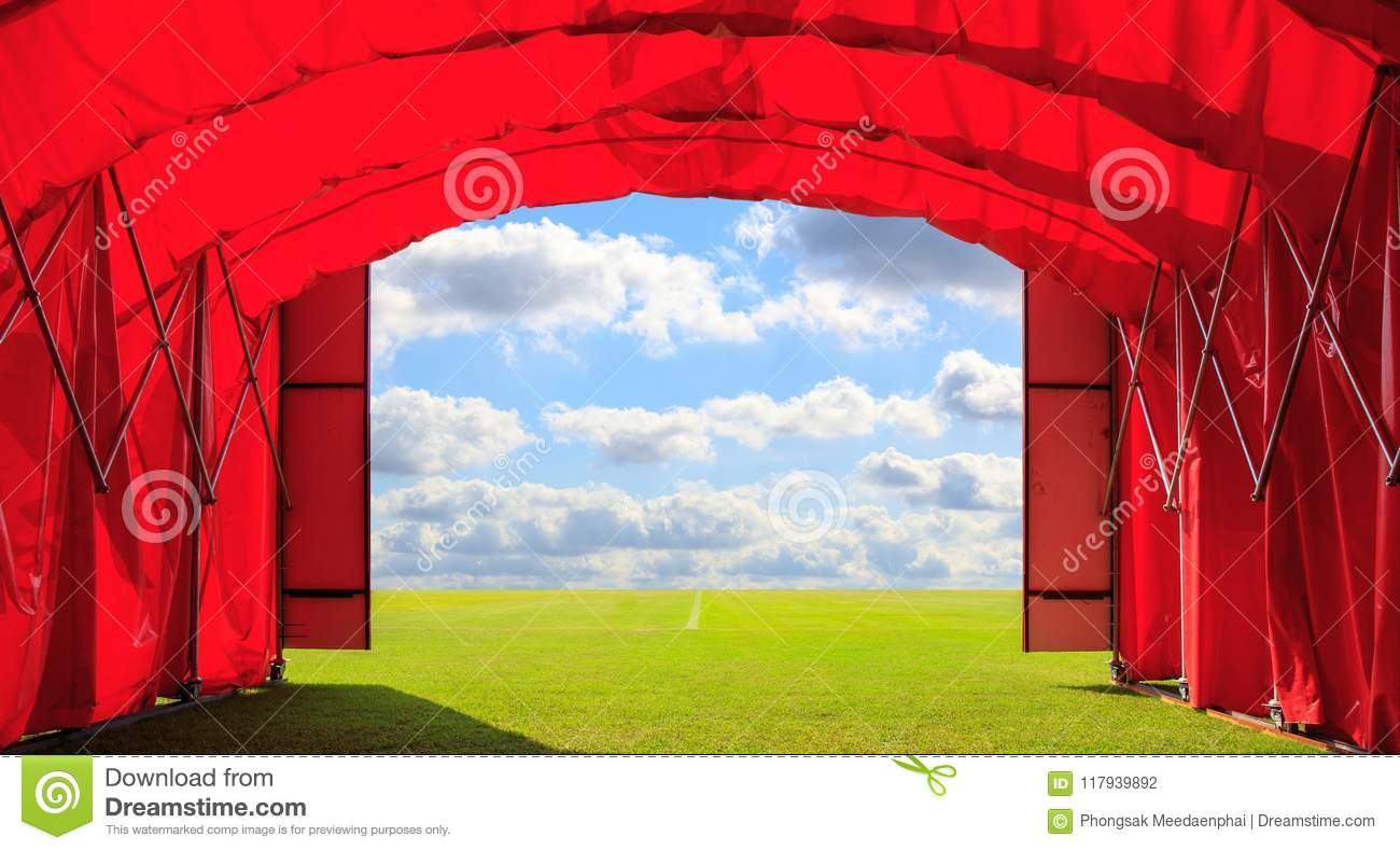 Entrance red gate of the football or soccer or baseball stadium with blue sky clouds background. Concept of opportunity to success