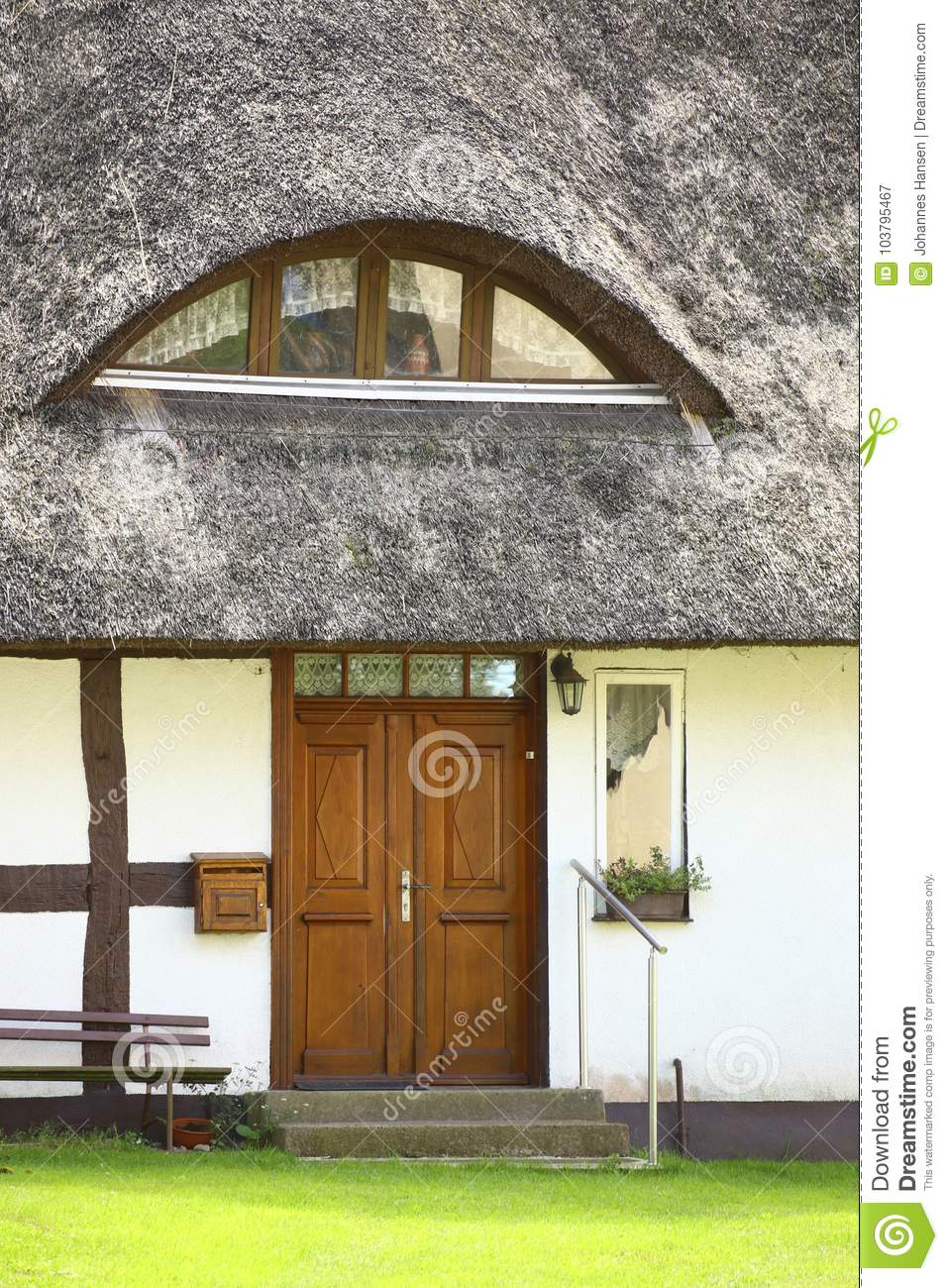 Entrance of reed roofed house, listed as monument in Kroeslin, Germany