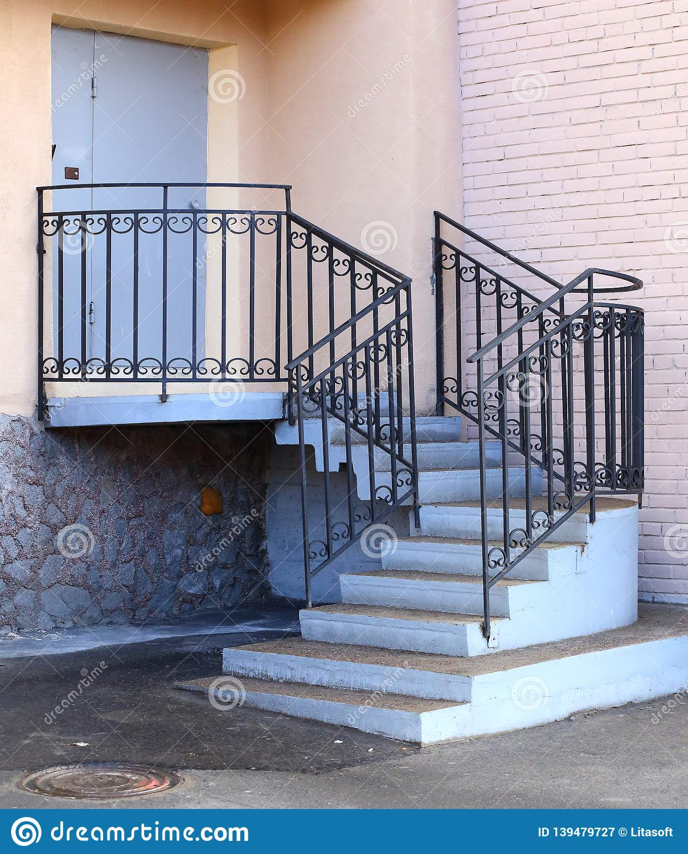 Entrance To The Building, Concrete Porch With Metal Railings Stock