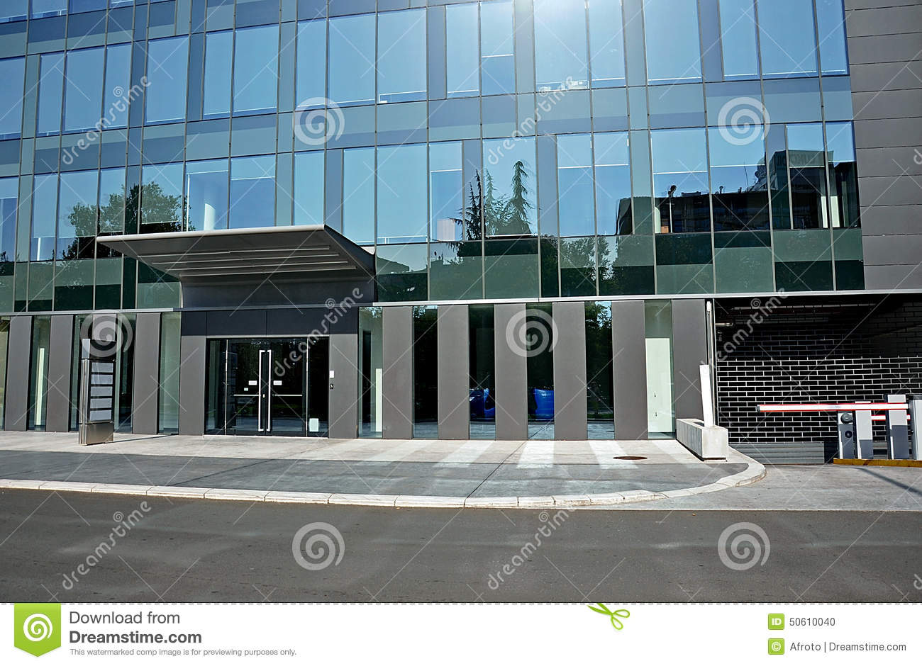 Modern glass hotel,front door with entrance to parking.