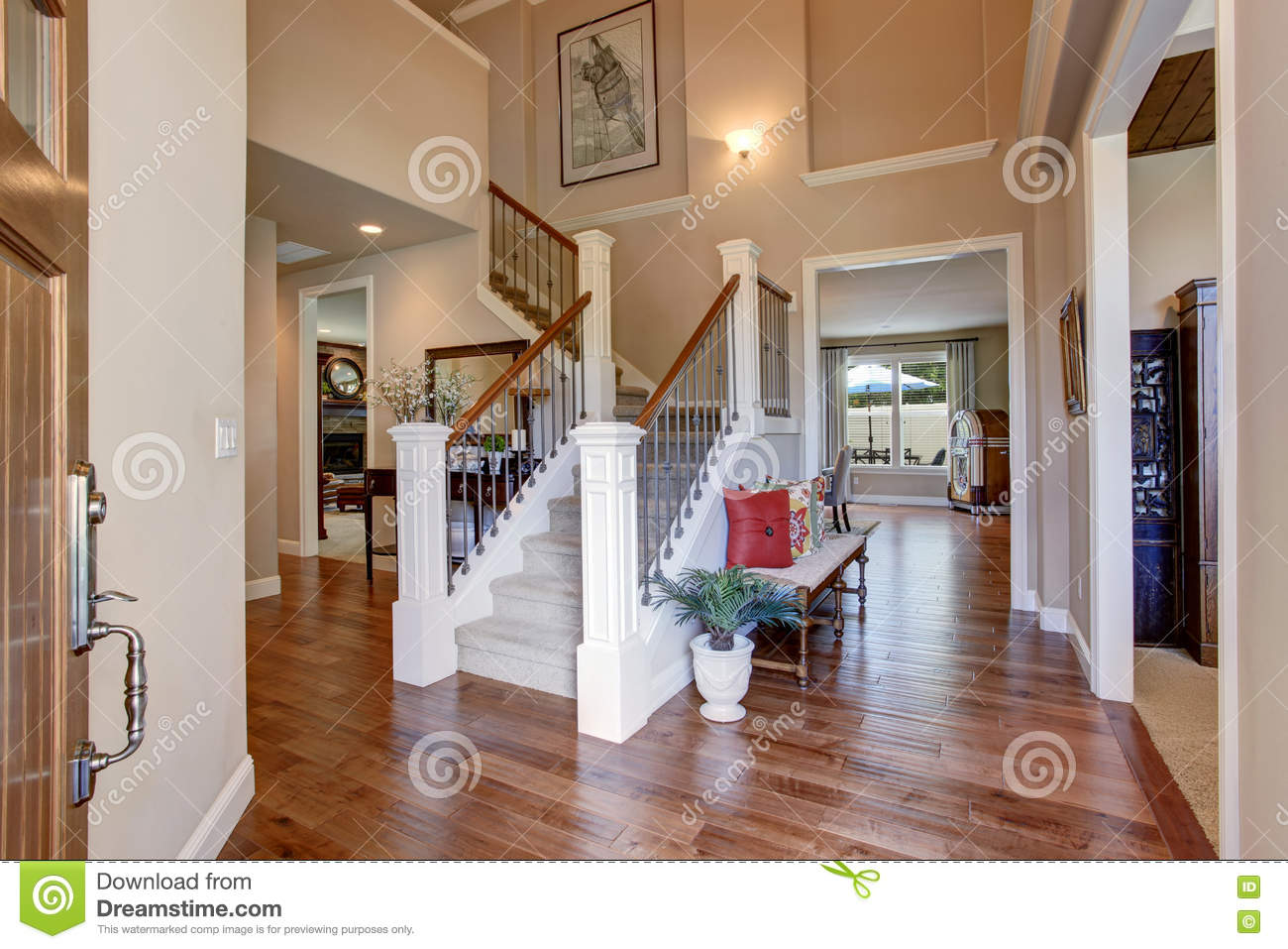 entrance to house with beige walls and hardwood floor indoor view
