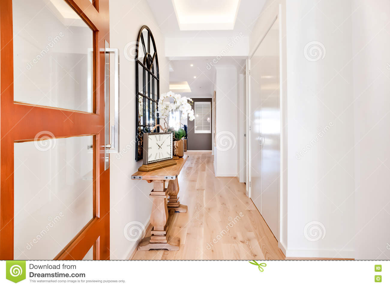 Entrance To A Luxury House Through The Hallway Including Furnitu Stock Photo