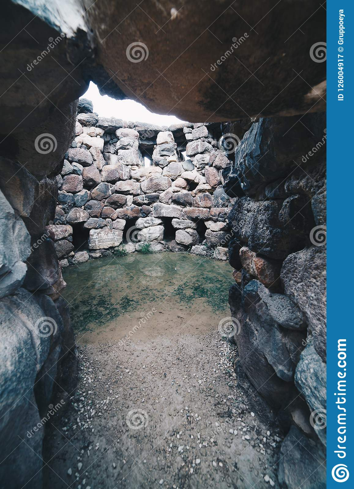 Entrance of a very old tower Nuraghe near Barumini in Sardinia - Italy.