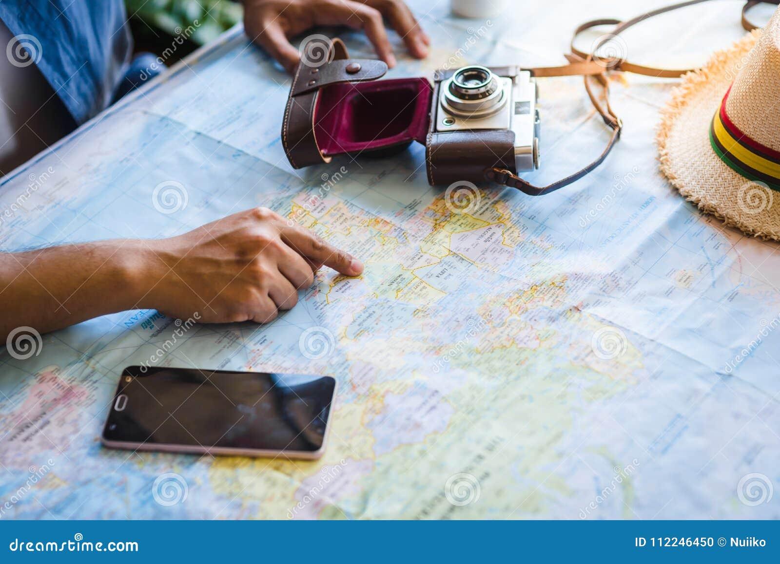 Entregue apontar o worldmap, planeando para a viagem seguinte
