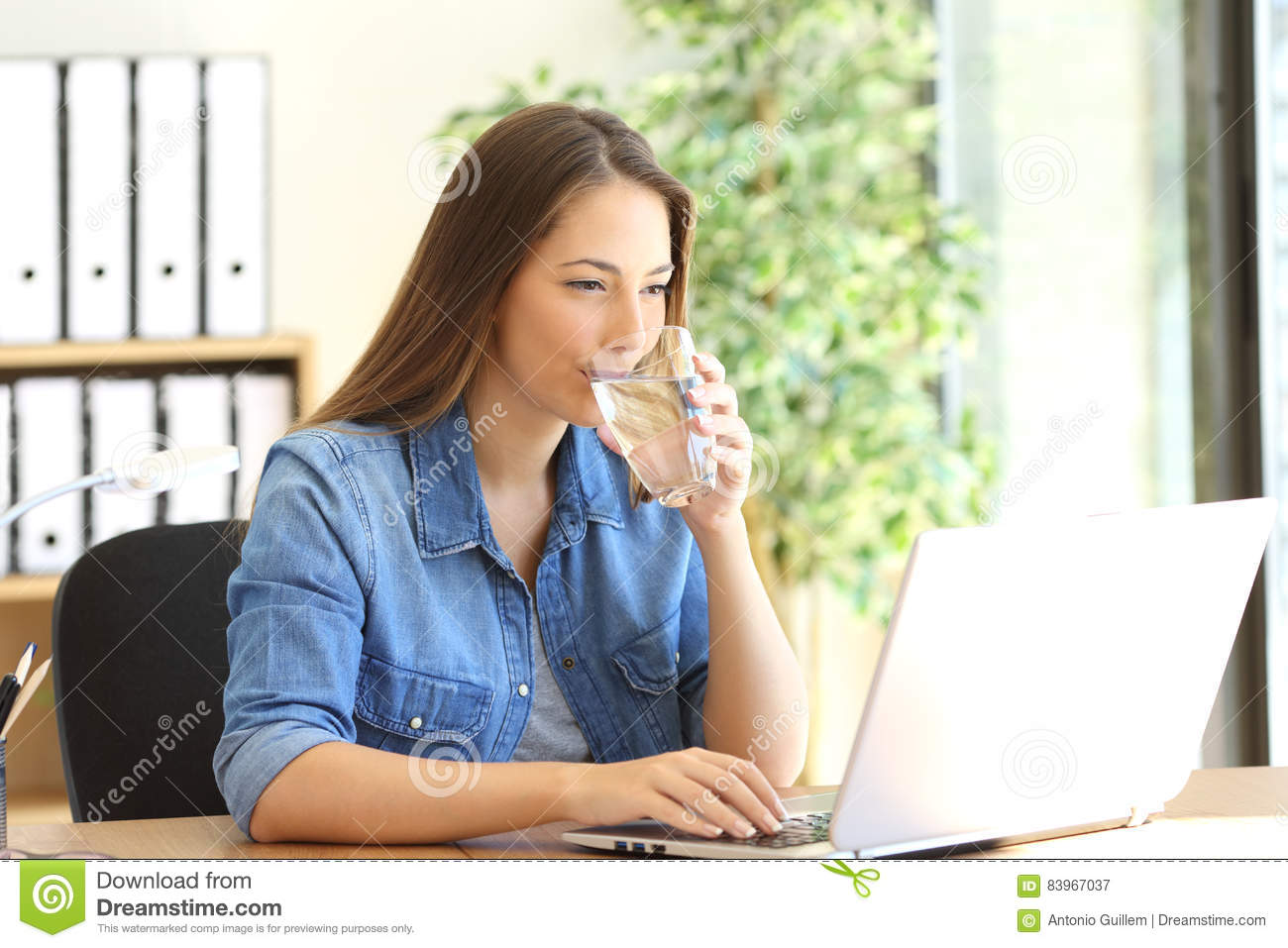 Entrepreneur drinking water and working