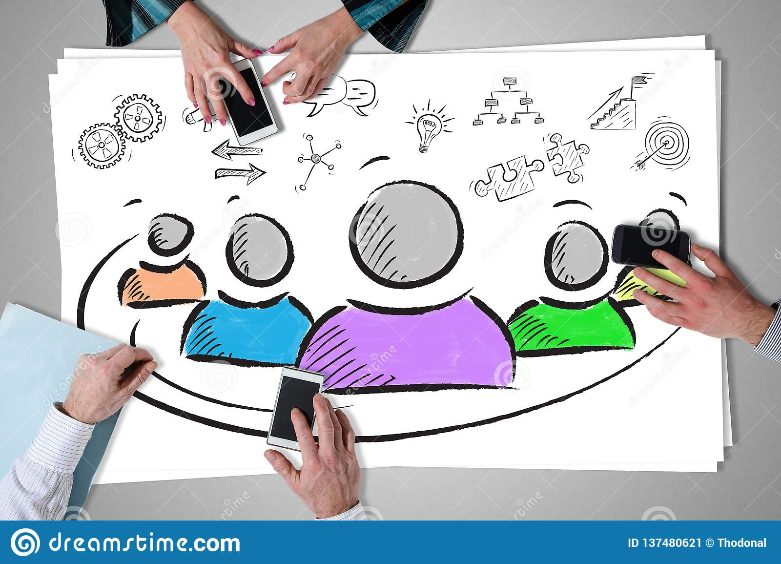 Entrepreneurship concept placed on a desk. With hands using smartphones stock image