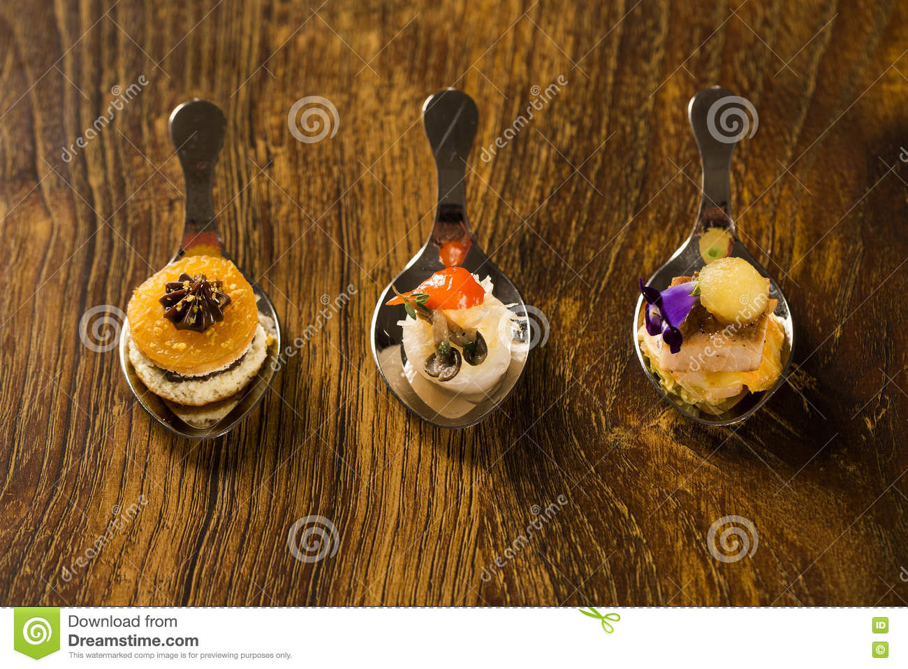 Entry, entree and dessert of finger food in a spoon.