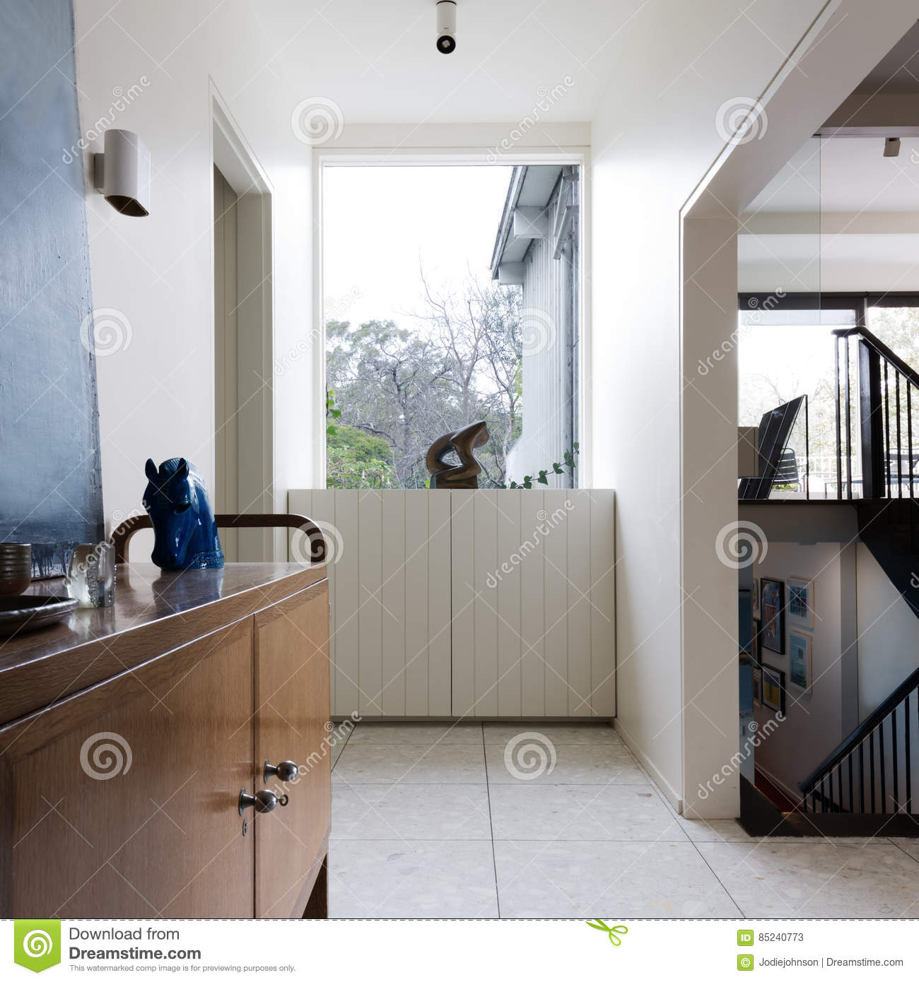 entry foyer in mid century modern home interior stock photo