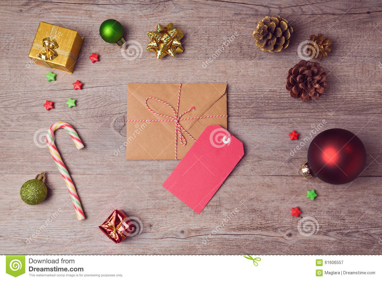 Envelope And Gift Tag With Christmas Decorations On Wooden ...