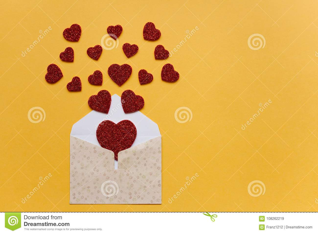 Envelope with symbols in the form of red hearts on a yellow background. Celebration.