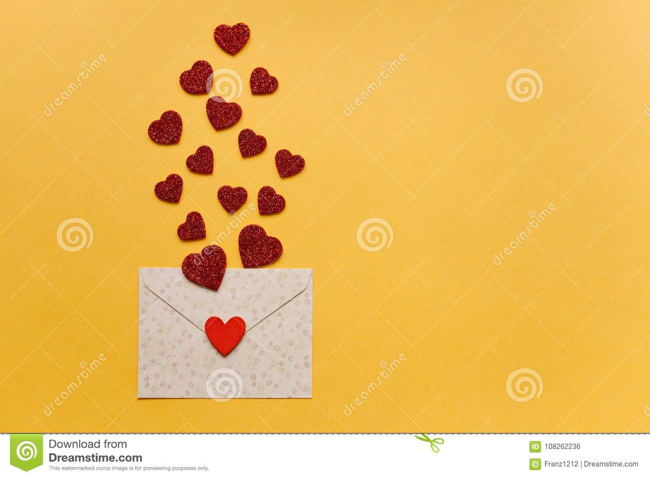 Envelope With Symbols In The Form Of Red Hearts On A Yellow