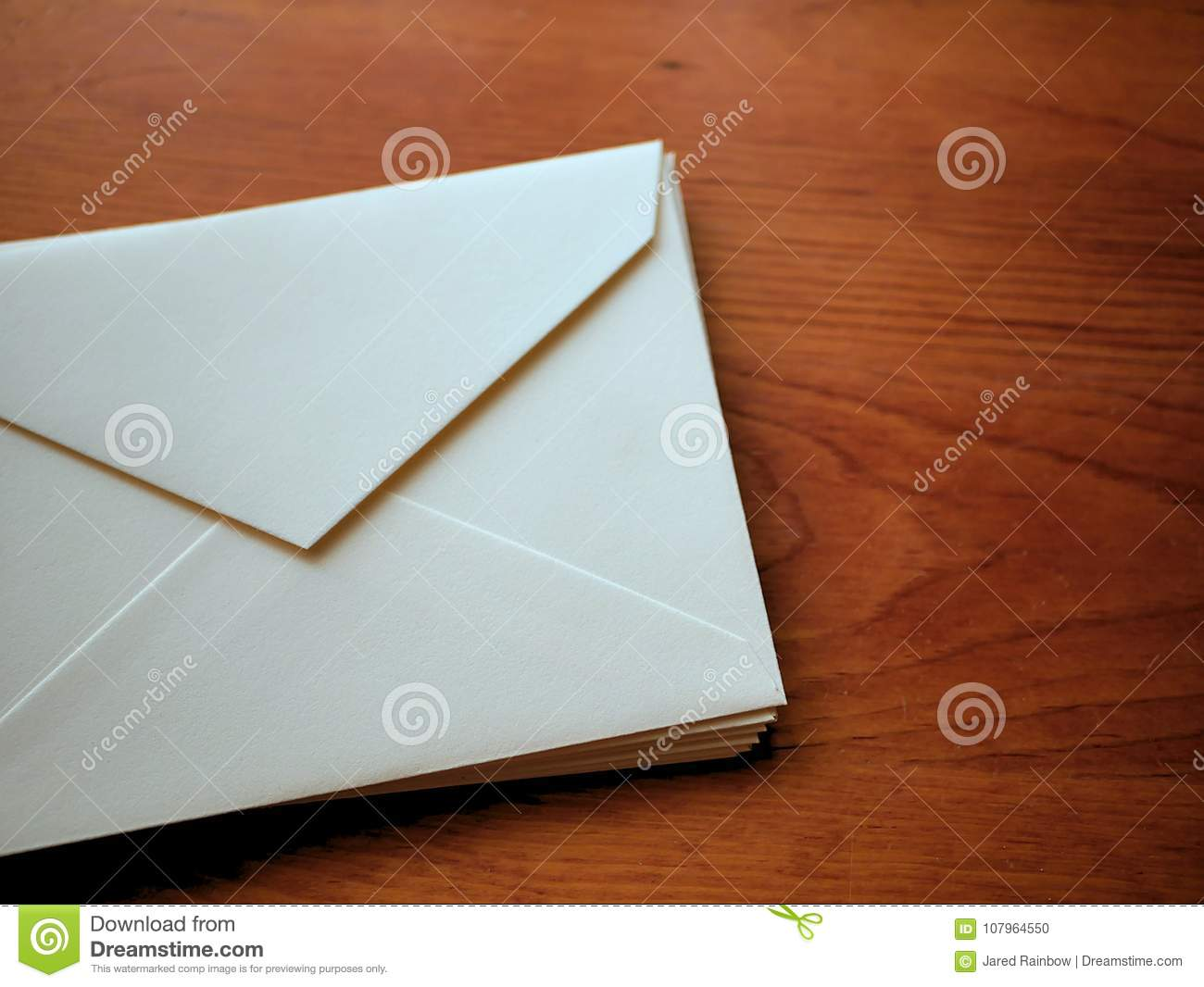 663214e699bb Envelopes And Stationery On Wood Grain Desk Background Stock Photo ...