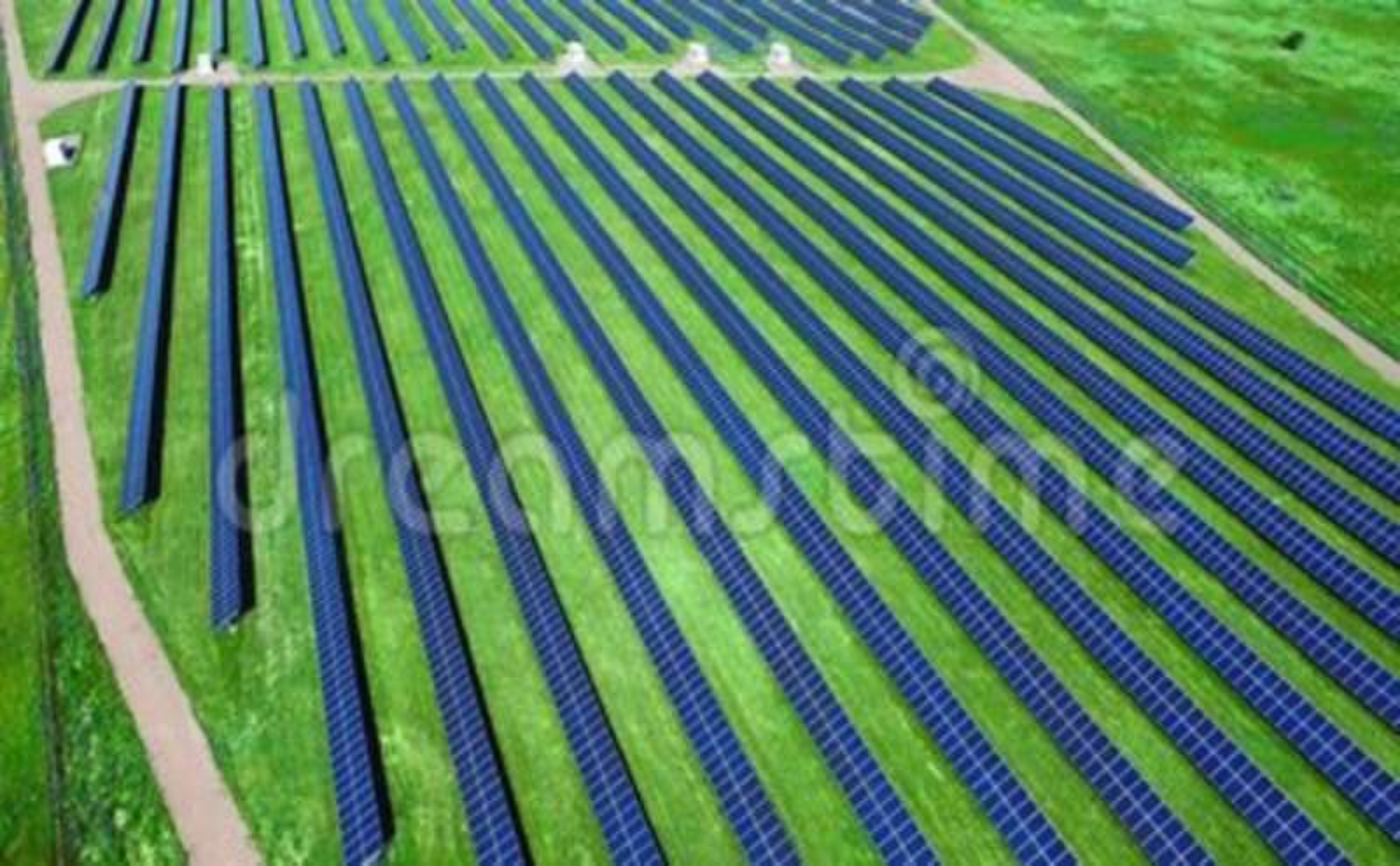 Environmentally friendly green energy farm. Modern solar power plant. Generation equipment. Aerial drone view on photovoltaic panels. Alternative green energy stock footage