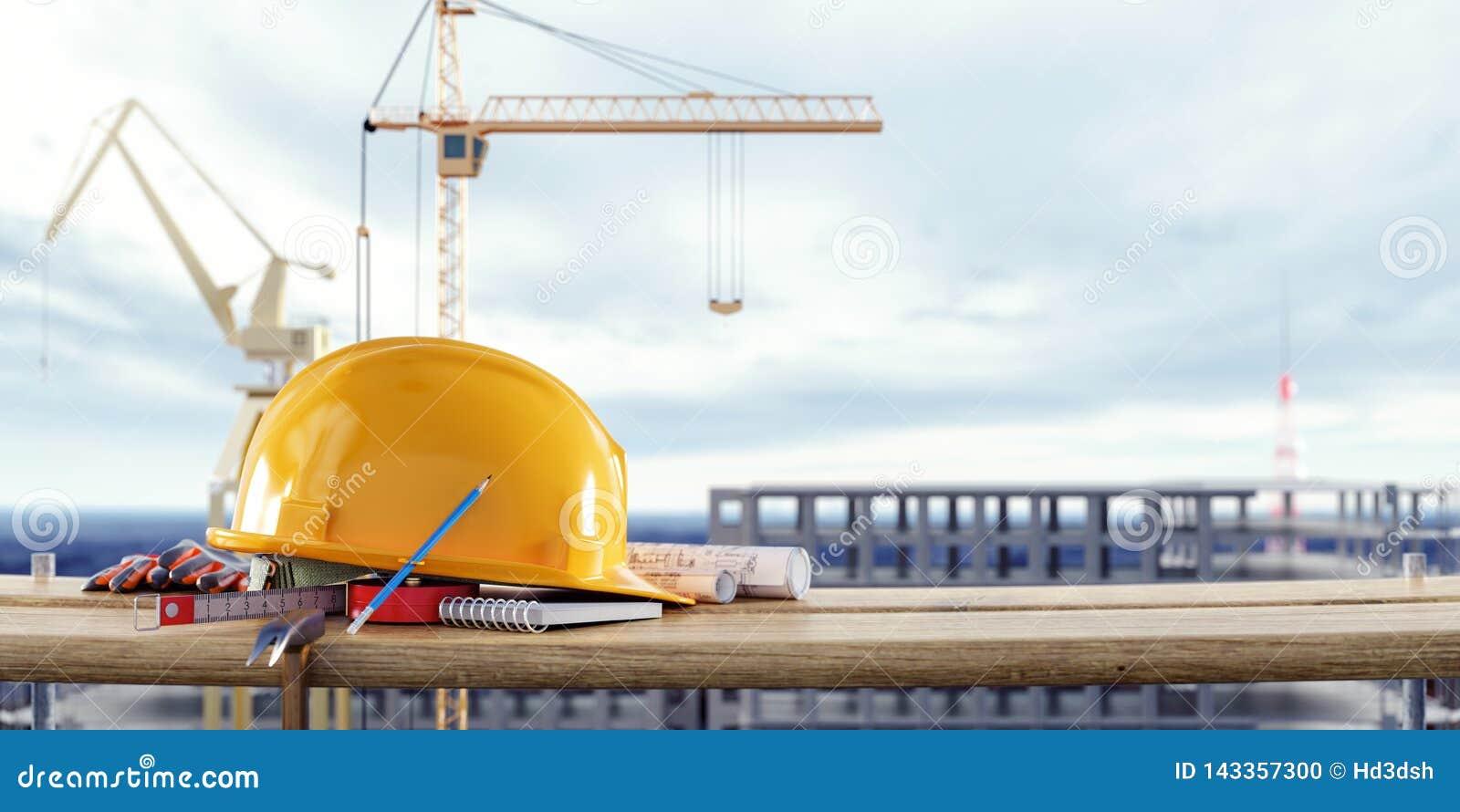 Equipamento de segurança da construção com os guindastes na frente da construção inacabado