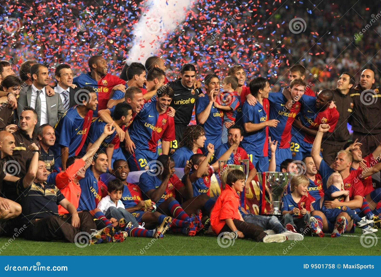 A equipe de Fc Barcelona comemora o La Liga