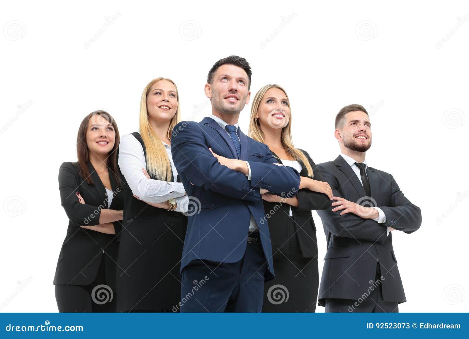 Equipe dos povos bem sucedidos e seguros que levantam em um backgr branco