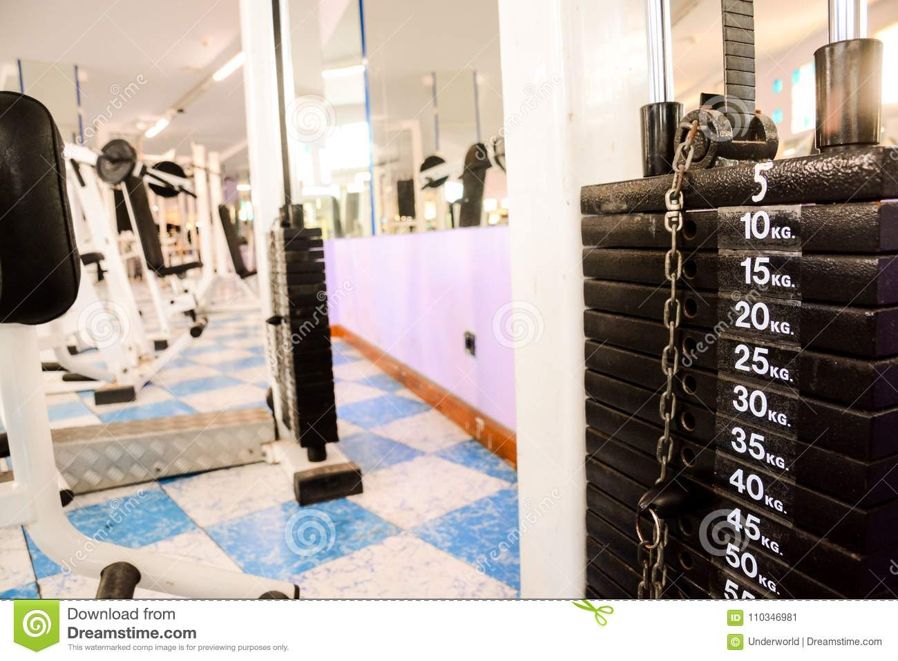 Equipment and machines at the empty modern gym room stock image