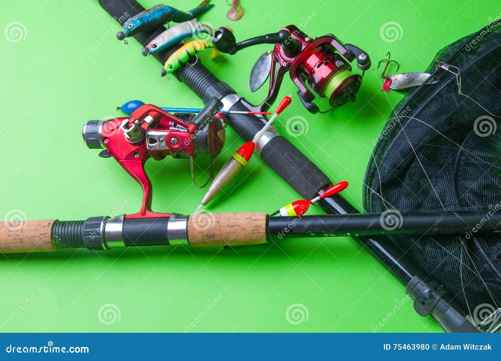 Equipo De Pesca En Un Fondo Verde Foto de archivo - Imagen de ... 2ad6488b500