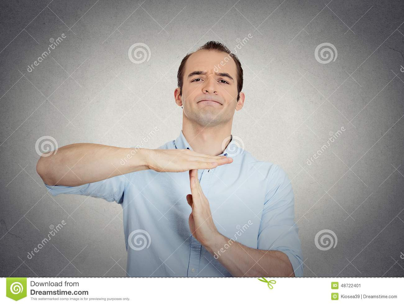 Erious confident business man showing time out gesture