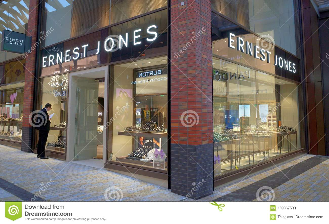 f8e5cfd530 Bracknell, England - January 31, 2018: A man looking at the window display  of the Ernest Jones jewellery store in Bracknell, England.
