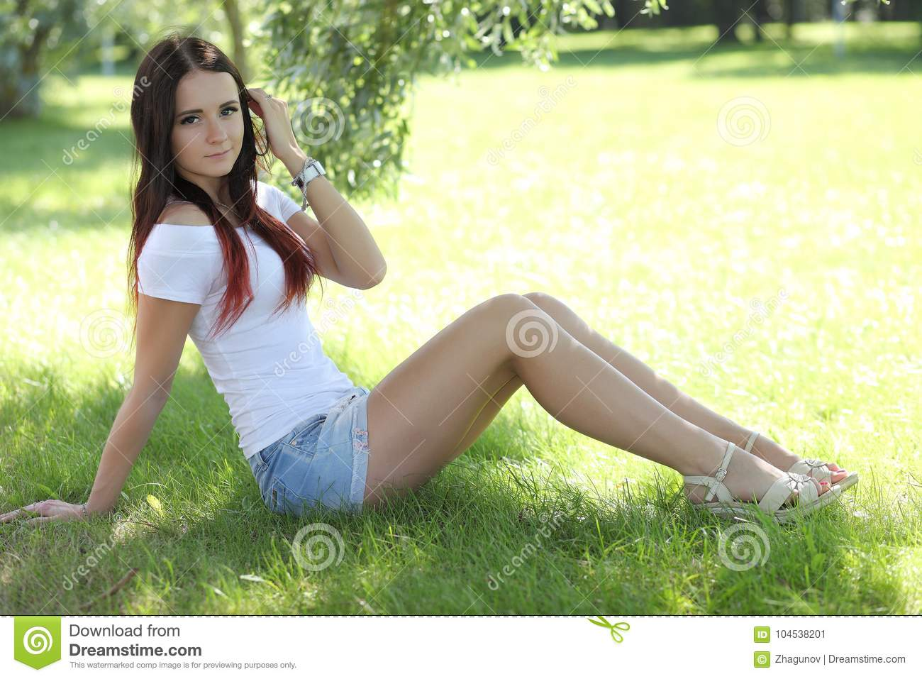 Erotic Girl With Mini Skirt On Green Grass
