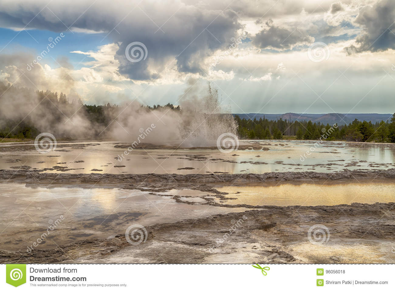 Erupting Great Fountain Geyser in Yellowstone National Park, Wyoming, USA